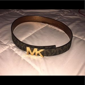 Michael Kors logo belt with price tag